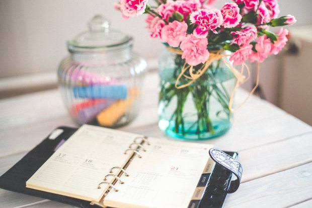 personal-organizer-and-pink-flowers-on-desk-6374